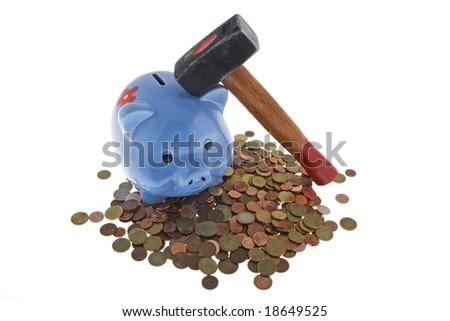Hammer crush piggy bank to fetch the nest egg - stock photo