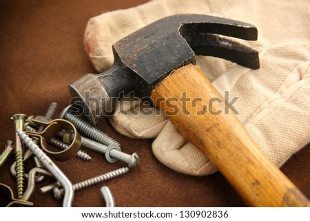 Hammer, glove and bolts. - stock photo