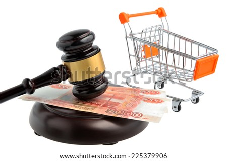 Hammer of auctioneer with pushcart and money isolated on white - stock photo