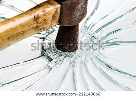 hammer smashes on glass with white background - stock photo