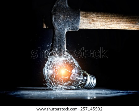 hammer tool destroy electric bulb high speed photo - stock photo