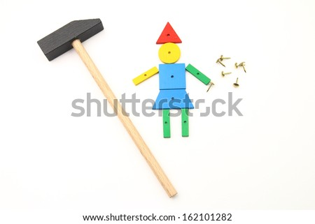 Hammer toy - creating a girl made up of colorful wooden pieces - stock photo