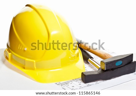 Hammers, hardhat and blueprint - stock photo