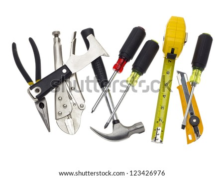 Hammers, screwdrivers, pliers and other tools on a white background