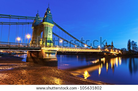 Hammersmith Bridge London at dusk - stock photo