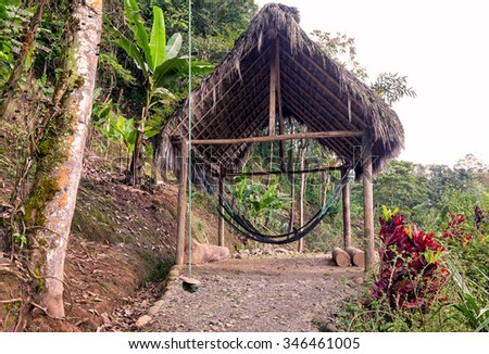 Hammock Braided Suspended From An Wooden Kiosk In The Amazonian Jungle