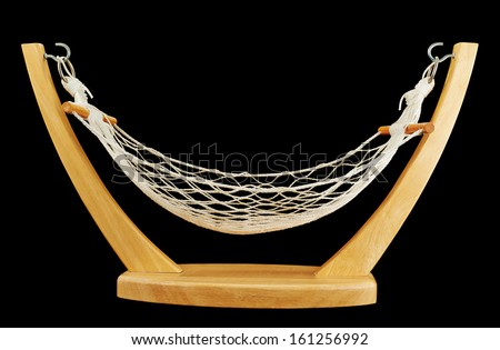 Hammock made of net and wood isolated over black background - stock photo