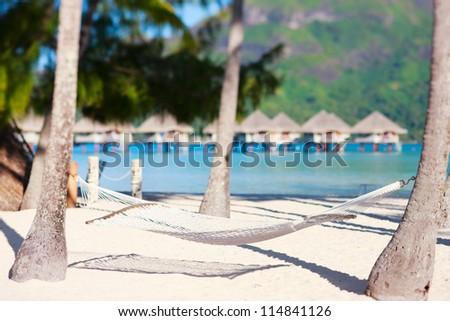 Hammock on a beautiful tropical beach - stock photo