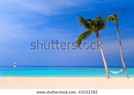 Hammock on a tropical beach - vacation background - stock photo