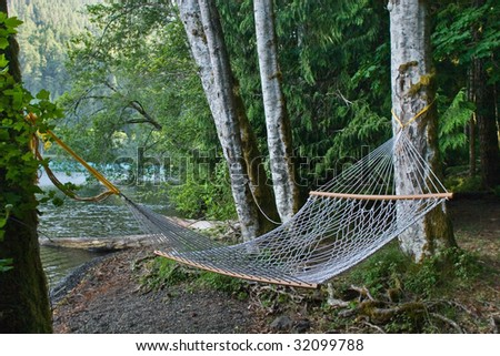 hammock on the lake shore - stock photo