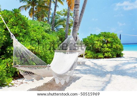 Hammock on the Maldivian beach - stock photo