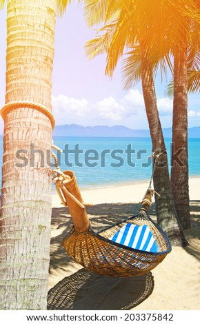 Hammock on the tropical white beach - stock photo