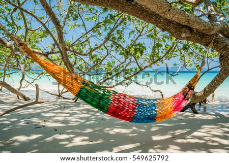 Hammock Tree Straps hang over the beach under shade, nobody on day time wide shot background at Nyaung Oo Phee, Myanma