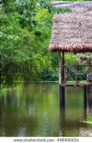 Hammocks on a balcony on stilts in the Amazon Rainforest near Iquitos, Peru - stock photo