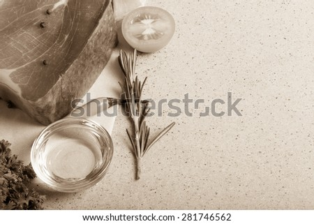 Hamon, herbs and spices on a stone table. Space for text. Toned.