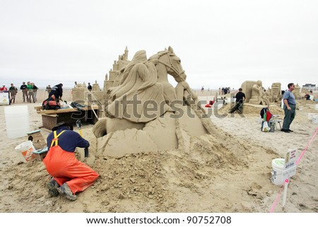 "HAMPTON BEACH, NH, USA - JUNE 28: ""And they Ride Among Us"" by Justin Gordon on display at the Master Sand Sculpting Competition on June 28, 2011 in Hampton Beach, NH, USA - stock photo"