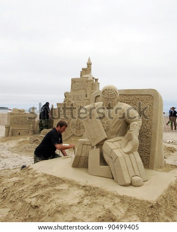 "HAMPTON BEACH, NH, USA - JUNE 28: ""Bruins MVP Tim Thomas"" by Greg Grady on display at the Master Sand Sculpting Competition on June 28, 2011 in Hampton Beach, NH, USA - stock photo"
