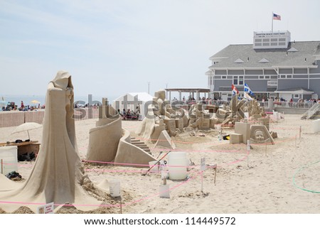 HAMPTON BEACH, NH, USA - JUNE 22: Crowds admire sand sculptures on display at the Master Sand Sculpting Competition on June 22, 2012 in Hampton Beach, NH, USA - stock photo
