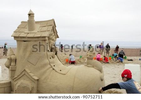 "HAMPTON BEACH, NH, USA - JUNE 28: ""There Was an Old Woman Who Sends Her Kids to Summer Camp"" by Karen Fralich at the Master Sand Sculpting Competition on June 28, 2011 in Hampton Beach, NH, USA - stock photo"