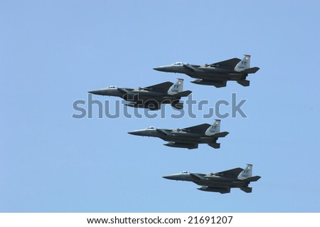 HAMPTON, VA - MAY 15: Four USAF F-15s fly in formation as they perform during the Langley AFB airshow on May 15, 2005 in Hampton, Virginia. - stock photo
