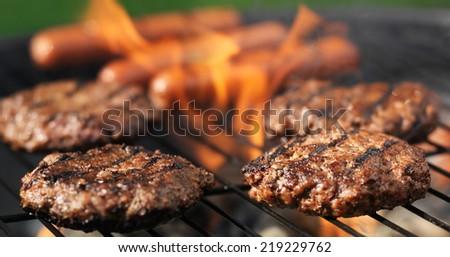 hamuburgers and hotdogs cooking panorama - stock photo