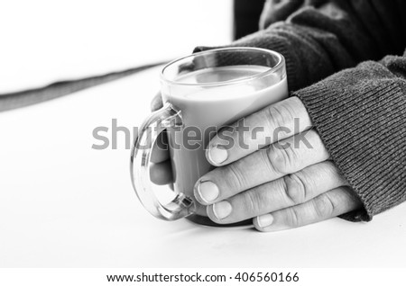 hand and a cup of coffee