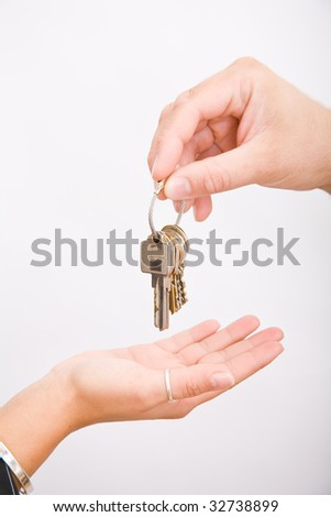 Hand and a lot os keys on white background