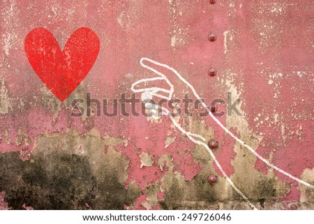 Hand and arm reaching for red heart , hand drawn on brick wall , trendy street style - stock photo