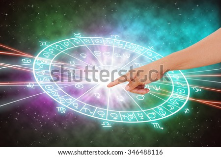 Hand and background of the horoscope concept. - stock photo