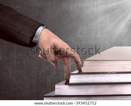 Hand and book stairs. Education for career concept - stock photo