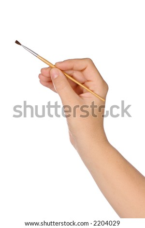 hand and brush over a white background