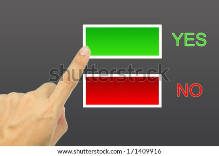 Hand and buttons Yes/No on gray background - stock photo
