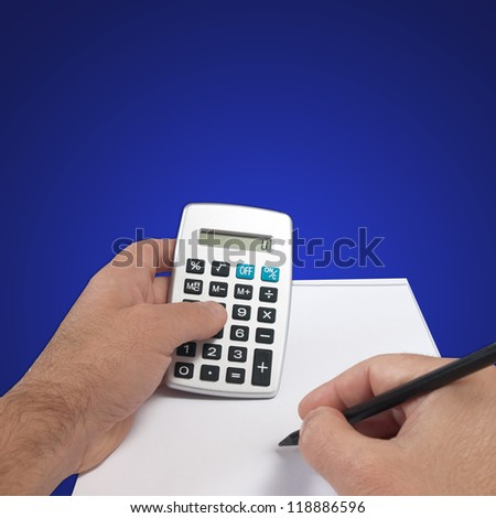 hand and calculator  isolated on gradient - stock photo