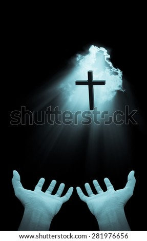 Hand and cross on Blue light beams background , concept design - stock photo