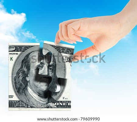 Hand and element money dollars puzzle isolated on white background - stock photo