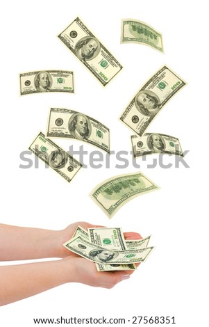 Hand and falling money isolated on white background - stock photo