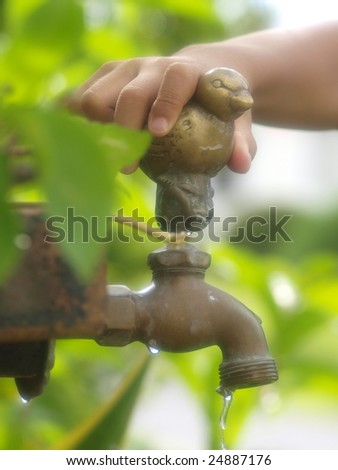 Hand and faucet