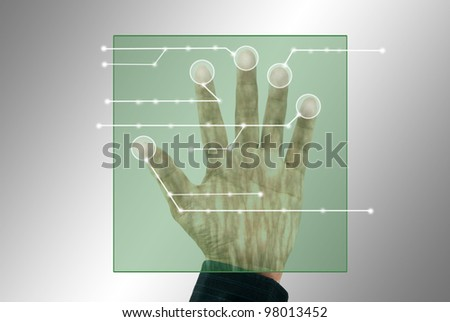 Hand and finger touching on virtual screen - stock photo