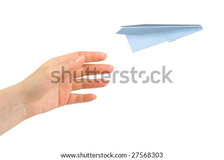Hand and flying money plane isolated on white background - stock photo