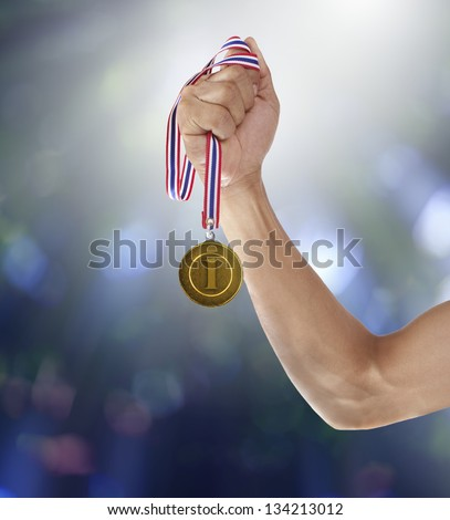 hand and gold medal - stock photo