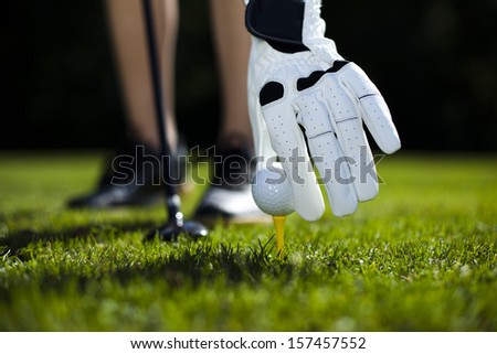 Hand and golf ball  - stock photo