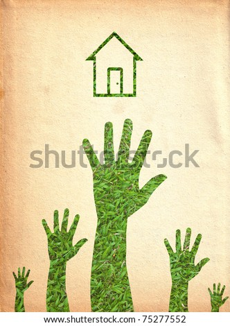 Hand and house.(Green energy concept) - stock photo