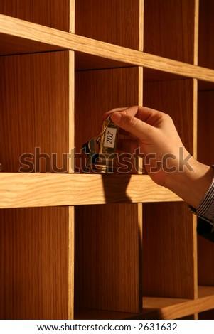 hand and key - stock photo