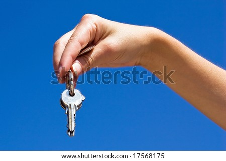 Hand and keys - stock photo