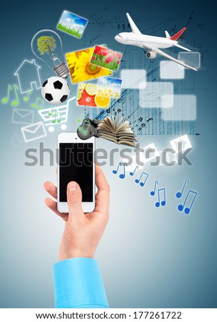 Hand and Multimedia phone concept - stock photo