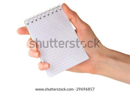 Hand and notebook - stock photo