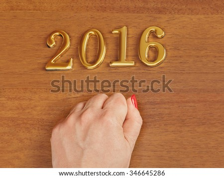 Hand and numbers 2016 on door - new year concept background - stock photo