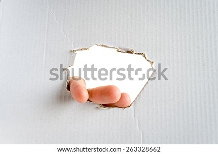 Hand and place for text on the cardboard background  - stock photo