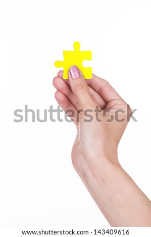 Hand and puzzle, isolated on white - stock photo