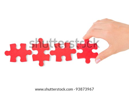 Hand and puzzle isolated on white background